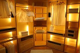 wood walk in closet with built in lighting