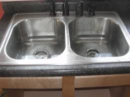 unclog kitchen sink with disposal donatz info stylish regard sinks clogged home remedy snless steel trough mercial kohler cast iron rugs and runners
