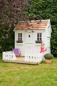 front of childrens wooden playhouse