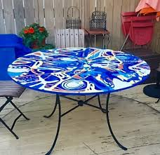 roof top patio 50 round table cast in multi colored concrete to achieve contemporary modern op art design