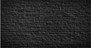 black brick wall texture with light