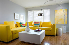 Yellow Living Room Decor Living Room Gray Recliners White Shelves Brown Chairs Gray Sofa