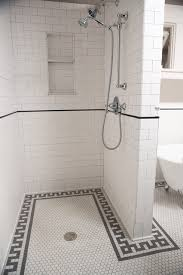 example of a large classic master subway tile and white tile mosaic tile floor and white