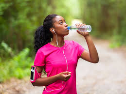 woman drinking bottled water outdoors run fitness exercise jog