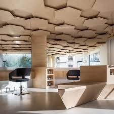 joshua florquin adds hexagonal patterned ceiling to paris hair salon