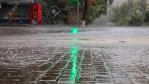 Looking For The Light Through The Pouring Rain At The Crossroads Of The Road The Green Light Of A Traffic Light