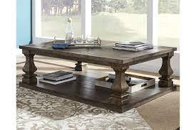 The powdercoated bases are made of tubular metal. Johnelle Coffee Table Ashley Furniture Homestore