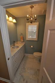 check out the chandelier in this powder room too what a great new space
