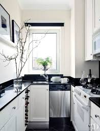 photo home stratosphere dark countertops white cabinets and walls