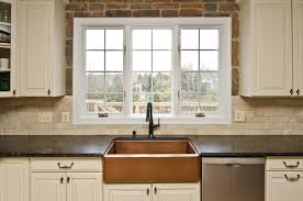 honey colored cabinets with revelation bordeaux granite