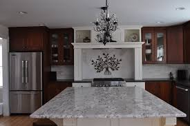 Impressive Monte Carlo Granite with Modern Kitchen Wood Hood