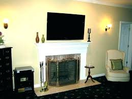 tv mounted on fireplace mount over fireplace mounted above fireplace ideas mount ideas bedroom wall mount