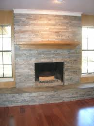 slate fireplace love how this extends below both windows