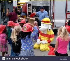sparky the fire dog. sparky the fire dog plays with children during a prevention awareness event at child development center cdc goodfellow air force base, texas,