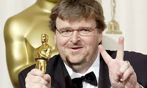 Michael Moore flashes the peace sign as he holds his Oscar for best documentary feature at 2003 Academy Awards. Photograph: Stringer/USA/Reuters - Michael-Moore-001