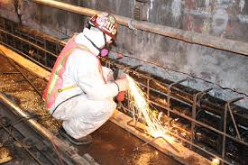 worker securing rebar to wall of steinway tunnel rebar worker