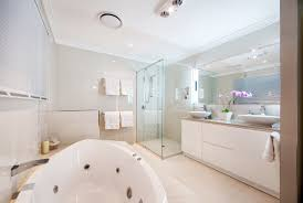 gray wall paint standalone bathtub ceramic flooring tile glass shweor cabin partition white real wood vanity