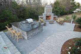 brick concrete outdoor kitchen with fireplace