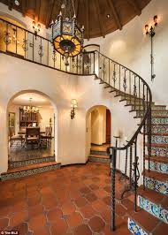 Spanish style: The luxury villa features a staircase curving up to the  second floor.