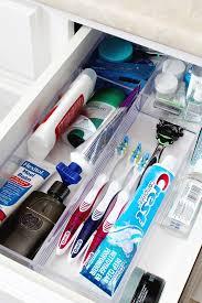 organized bathroom drawer using an acrylic drawer divider tray