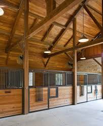 i like the overhead lighting horse barn lighting ideas found on texastimberframes com