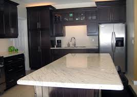 white granite dark cabinets