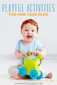 toddler boy playing playful activities for 1 year olds