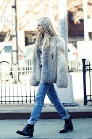 shea marie pairs this authentic fluffy faux fur coat with rolled jeans and a pair of