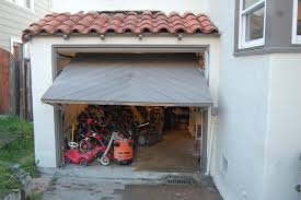 low clearance garage doorHow can I replace a tilt up garage door with near zero clearance