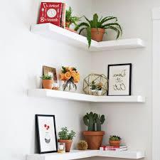 white solid wood corner living room floating shelves