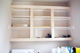 installing diy laundry room cabinets