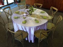 5 foot round table lilac dupioni with a burlap table runner and moss dupioni napkins on