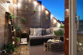 rooftop lighting. Decorations:Warm Outdoor Rooftop Patio Area With Romantic Lighting Overlooking City View Design G
