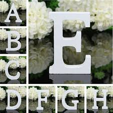 large wooden hanging wall letters u