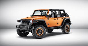the jeep wrangler rubicon sunriser features exclusive matte orange paintwork in addition to a host of mopar accessories such as pers with a double tow