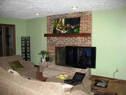 mount tv over fireplace gas burning fireplace exterior wall