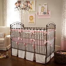small baby room ideas. Impressive Small Baby Girl Nursery Pink Lion Print Bumper Brown Metal Crib White Skirt Pattern Curtain Room Ideas