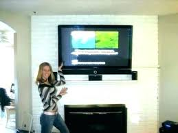 tv above fireplace where to put cable box mounting over fireplace hang above fireplace hanging over