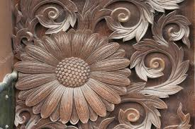 art wooden carvings of sunflower on the temple s gate door higashi honganji temple in kyoto japan photo by