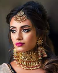 if you are looking for simple indian bridal makeup look for the day then definitely go for golden eyes and peach or pink lips with soft curls to plete