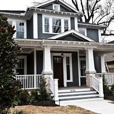 exterior paint ideas dark trim. exterior curb appeal. white trim, brick and sherwin williams grizzle gray paint ideas dark trim a