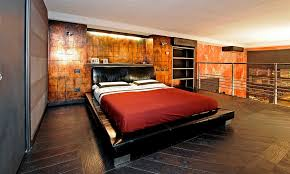 oxidized copper plates make for a dramatic accent wall in the bedroom design marco