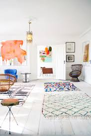 Multiple Rugs In Living Room How To Mix Multiple Rugs In The Same Room Emily Henderson