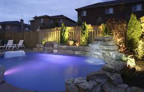 pool lighting design. A35ef1b9-backyard-pool-at-night-1200x773.jpg Pool Lighting Design