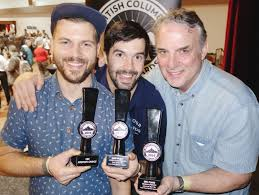 Adam and Brent Mills, with father and Four Winds Brewing founder Greg, were  happy that absent