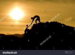 royalty couple hiking help teamwork and trust  couple hiking help teamwork and trust silhouette in mountains sunset and ocean male and
