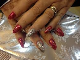 Almond shaped nails with red glitter and Swarovski ring fingers ...