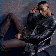 david agbodji rocks a knit sweater leather shirt jacket and skinny jeans from john