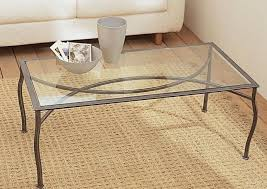 Metal Framed Glass Top Table With Metal Legs Light Brown Textured Rug