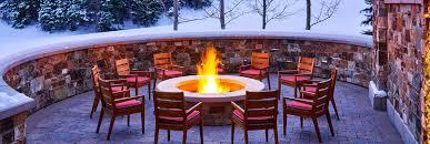 outdoor fireplace at st regis deer valley in the winter